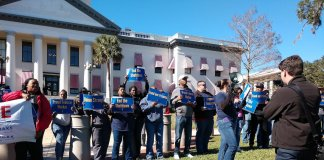 Government workers and their allies protested in front of old Capitol on Thursday
